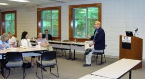 Members listen to keynote speaker Scott Miller